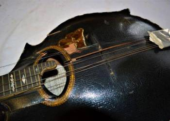 The mandolin as it arrived - the soundboard was smashed into 7 pieces