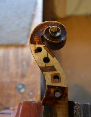 Violin scroll restoration